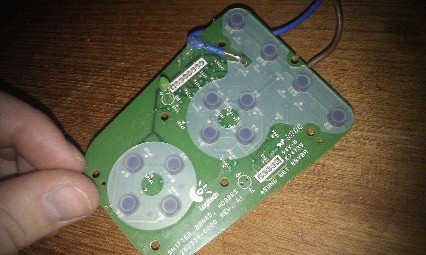 """""""Kretskortet"""" till kontrollpanelen i växelspaken - knappsidan"""